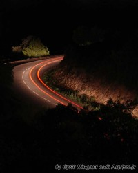 Car's headlights in a bend
